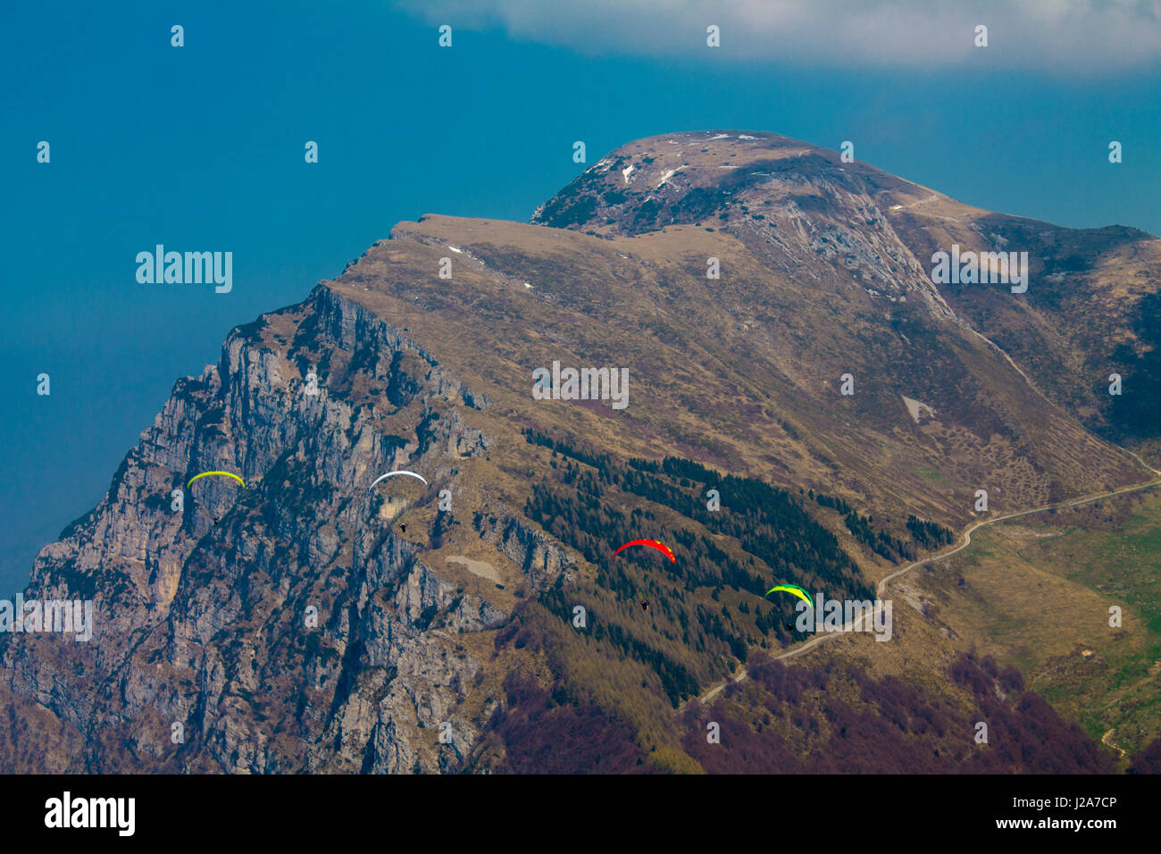 Wingsuit, Mount Baldo, Veneto Italy,Skydiver in flight against the backdrop of the mountain - Stock Image