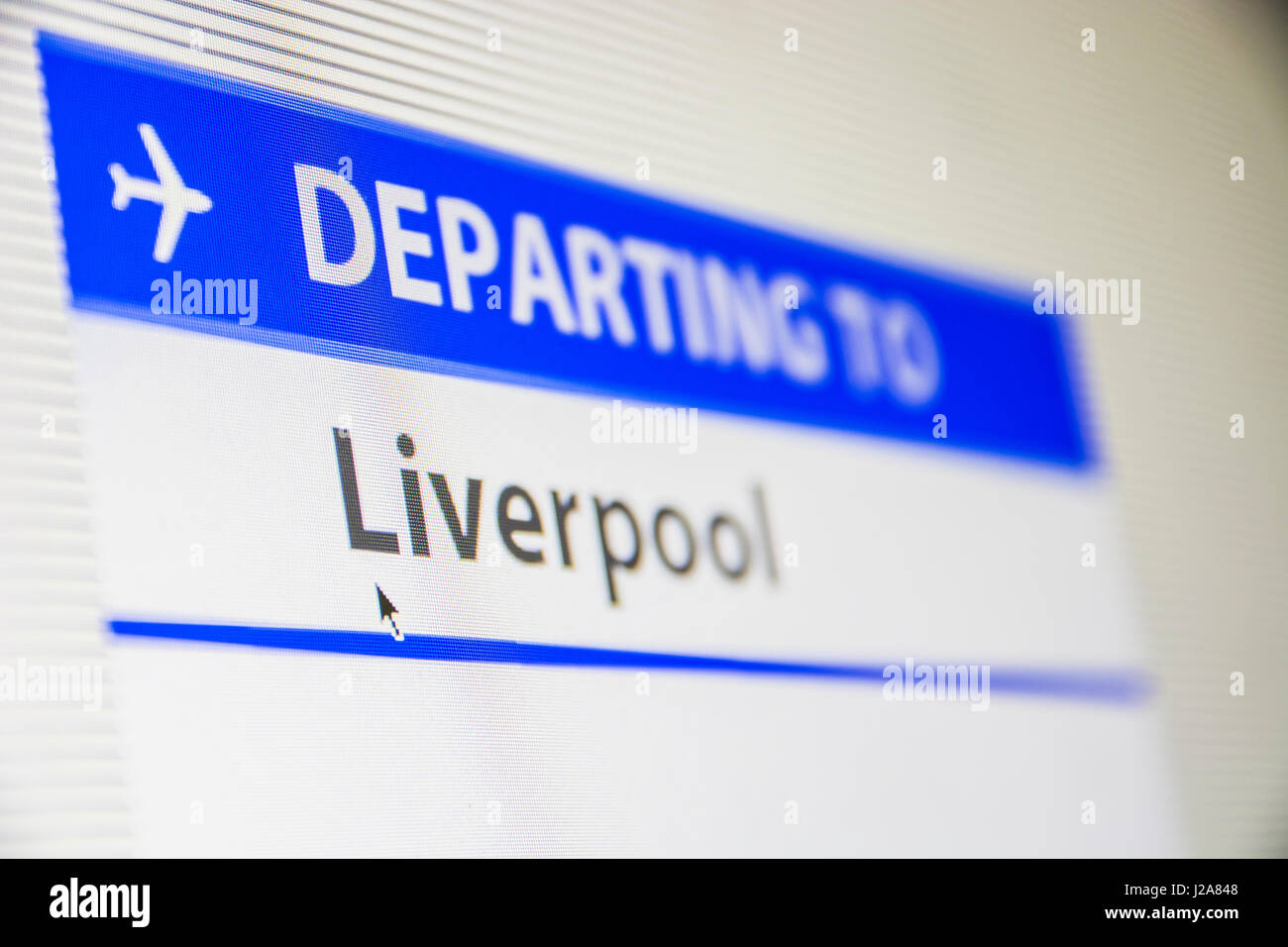 Computer screen close-up of status of flight departing to Liverpool, England, UK - Stock Image