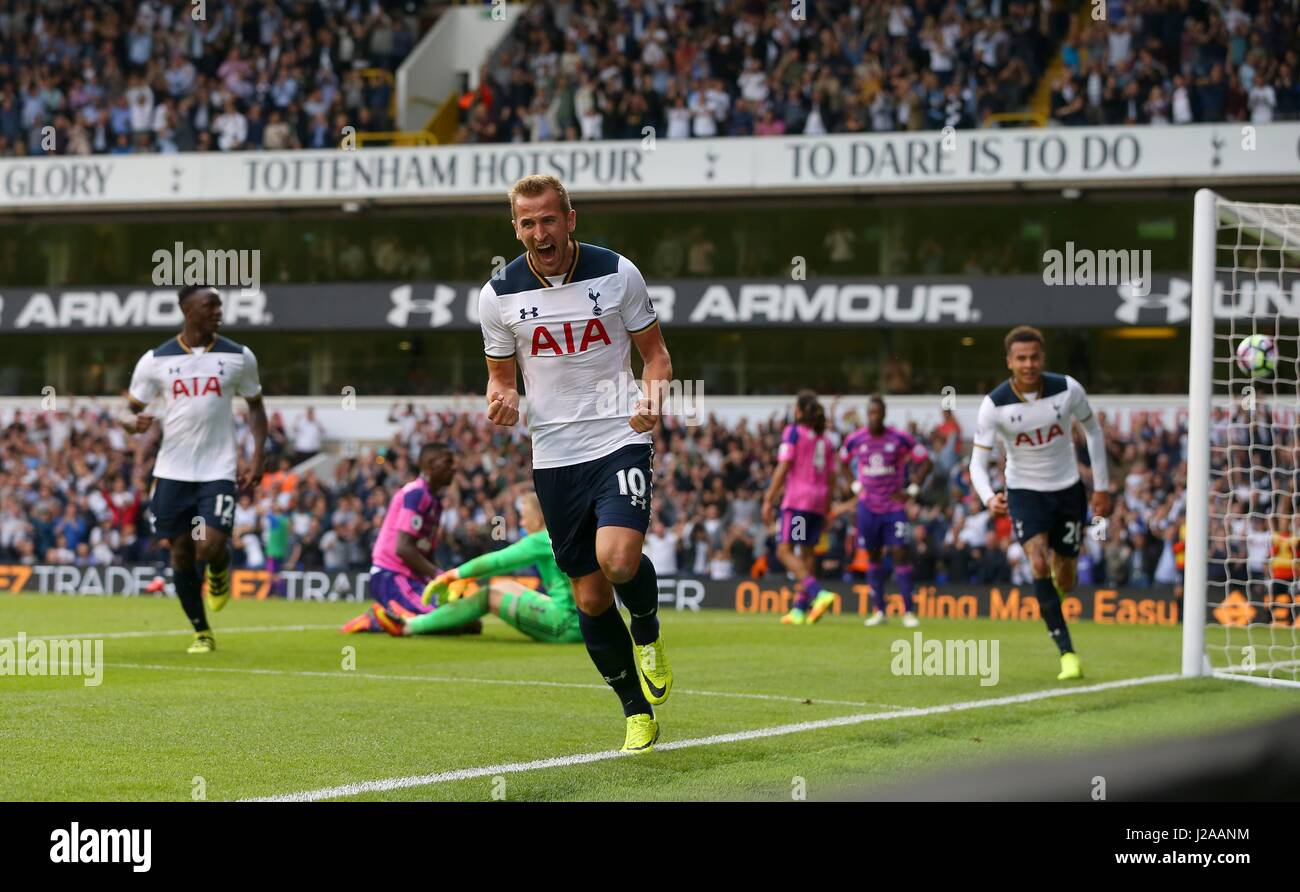 Harry Kane of Tottenham celebrates scoring the opening goal during the Premier League match between Tottenham Hotspur - Stock Image