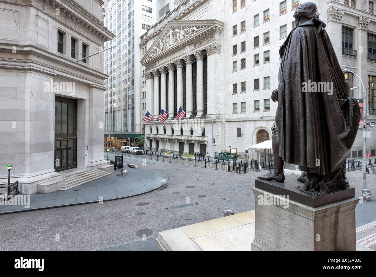 A view of Wall Street from the steps of the Federal Hall on a sunny day in New York, NY. - Stock Image