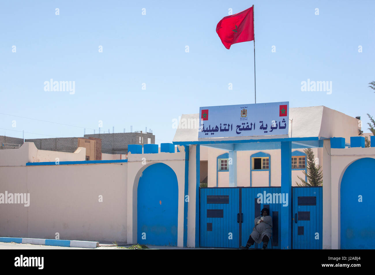 Africa, Western Sahara, Dakhla. Security outside a Moroccan government building. - Stock Image