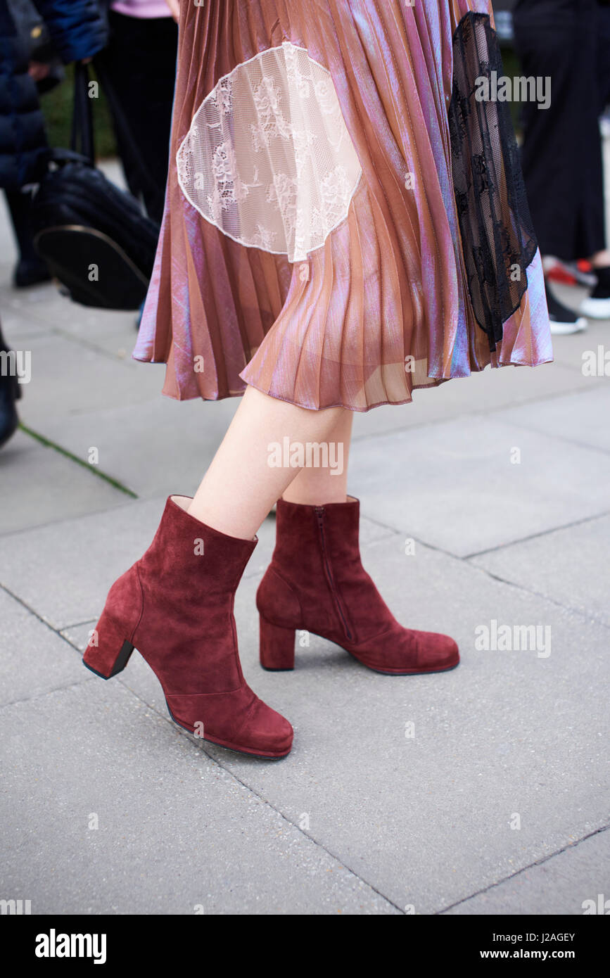 LONDON - FEBRUARY, 2017: Low section of woman wearing chiffon and lace pleated skirt with suede ankle boots in the - Stock Image