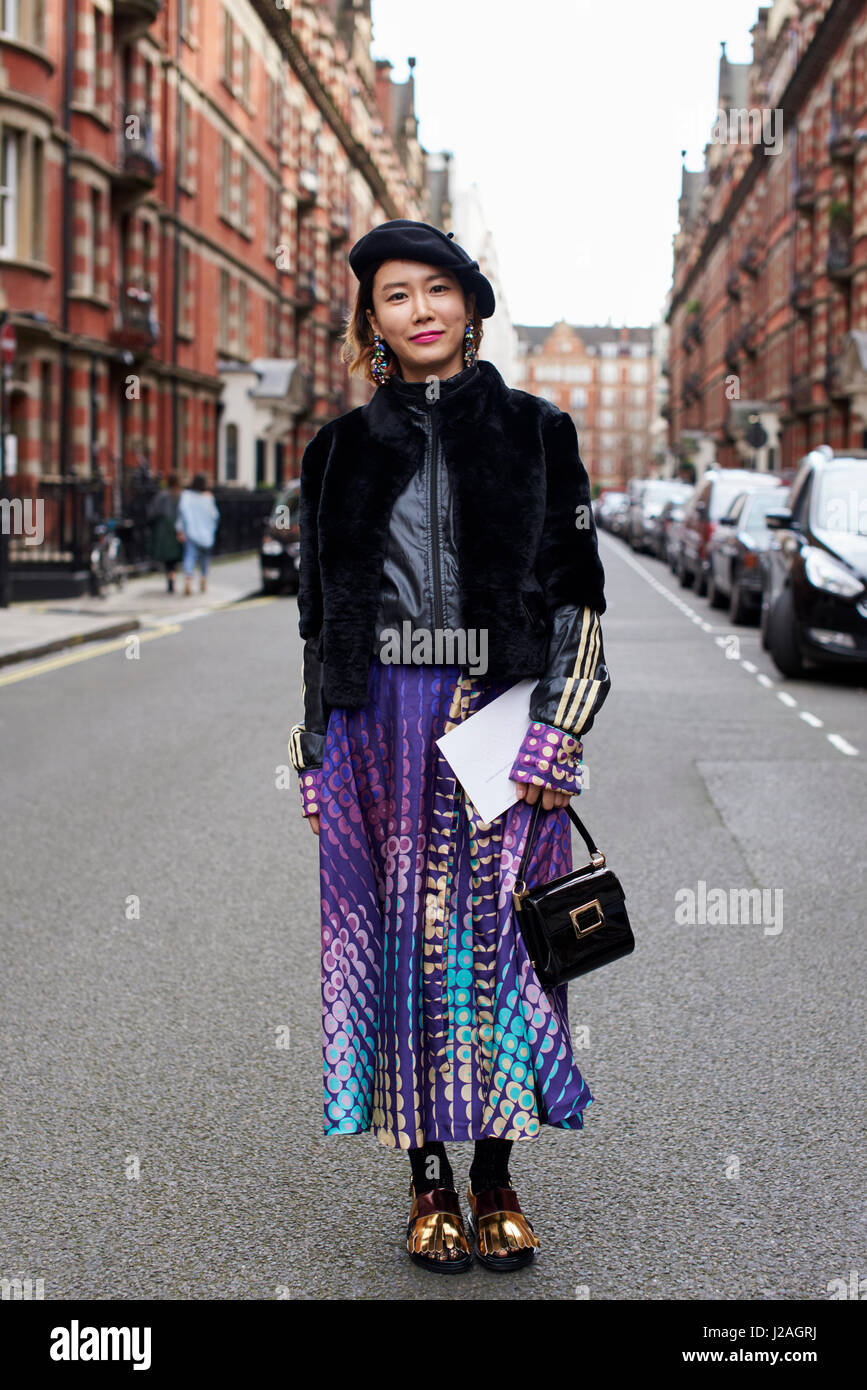 LONDON - FEBRUARY, 2017: Full length view of woman standing in street after leaving Sharon Wauchob fashion show, - Stock Image