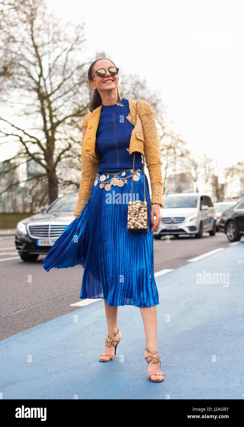 LONDON - FEBRUARY, 2017: Full length view of woman leaving Christopher Kane fashion show, London Fashion Week, day - Stock Image