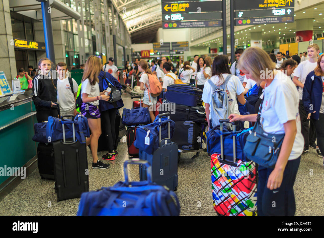 Junior High School students, teachers, parents arriving at Guangzhou airport, China - Stock Image