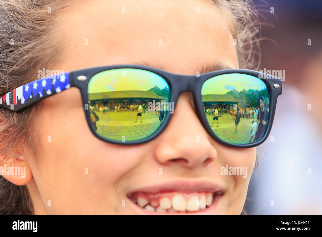 Sunglass reflections from teen girl visiting The Great Wall, Modern Seven Wonders of the World, Qianjiadian Scenic - Stock Image