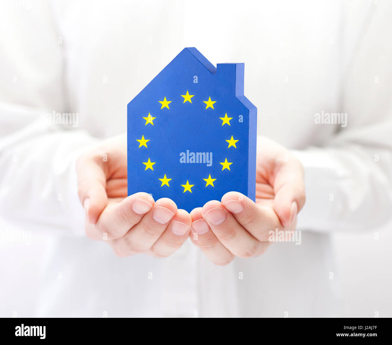 House with European Union flag in hands - Stock Image