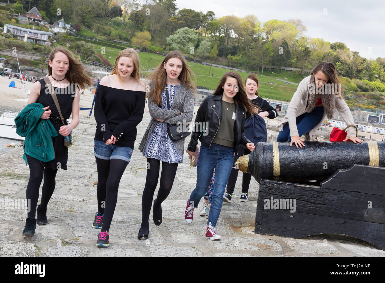 Teenagers UK - Teenage girls walking on the Cobb, Lyme Regis, Dorset England UK - Stock Image