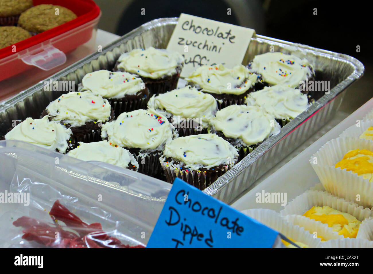 Items set up for sale at a bake sale. - Stock Image