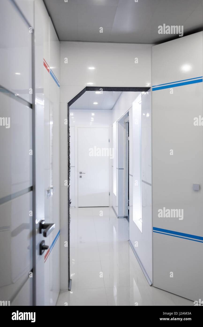 Modern home hallway interior. White plactic panels and tiles Stock ...