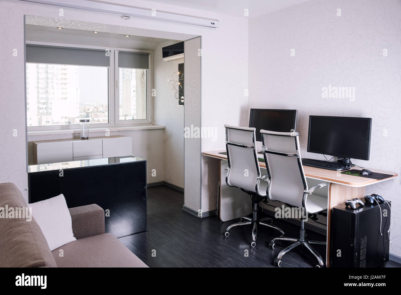 Interior of modern apartment with workplace Stock Photo