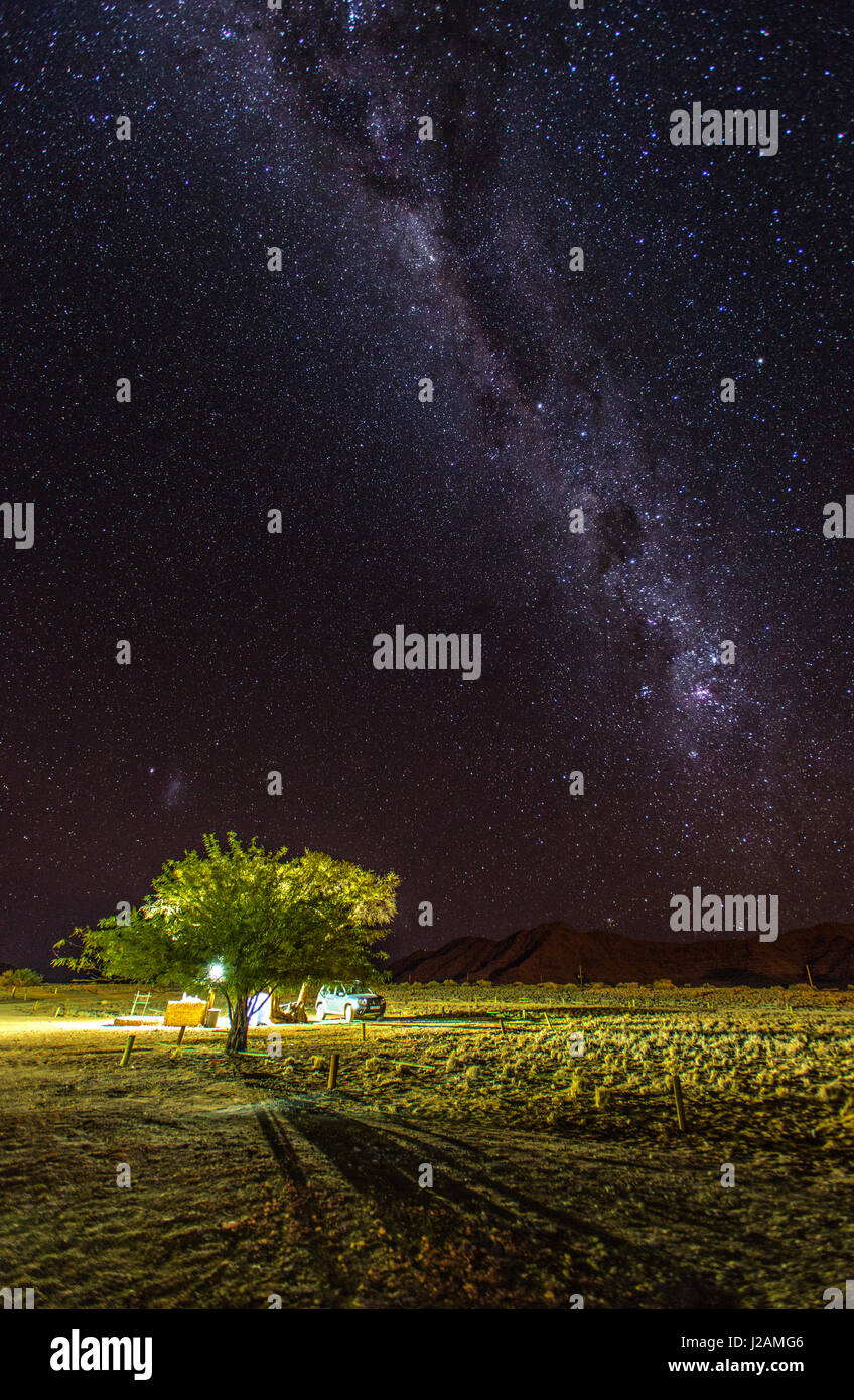 Countless sky of the Milky Way lit up an otherwise dark sky in the Namibian desert, near the Sossusvlei region. - Stock Image