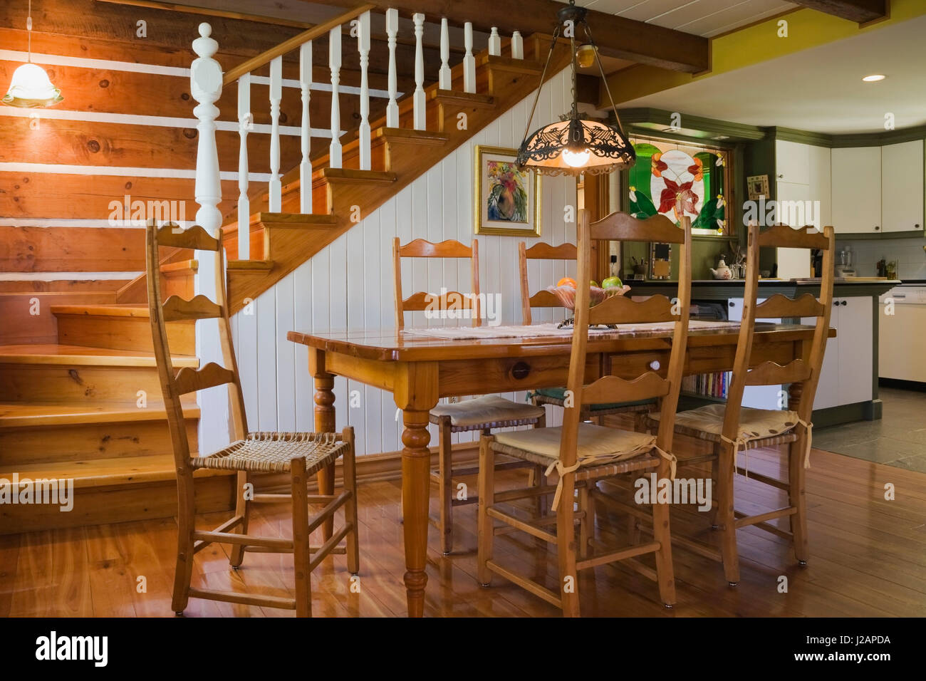 Antique Wooden Dining Table And High Back Chairs In The