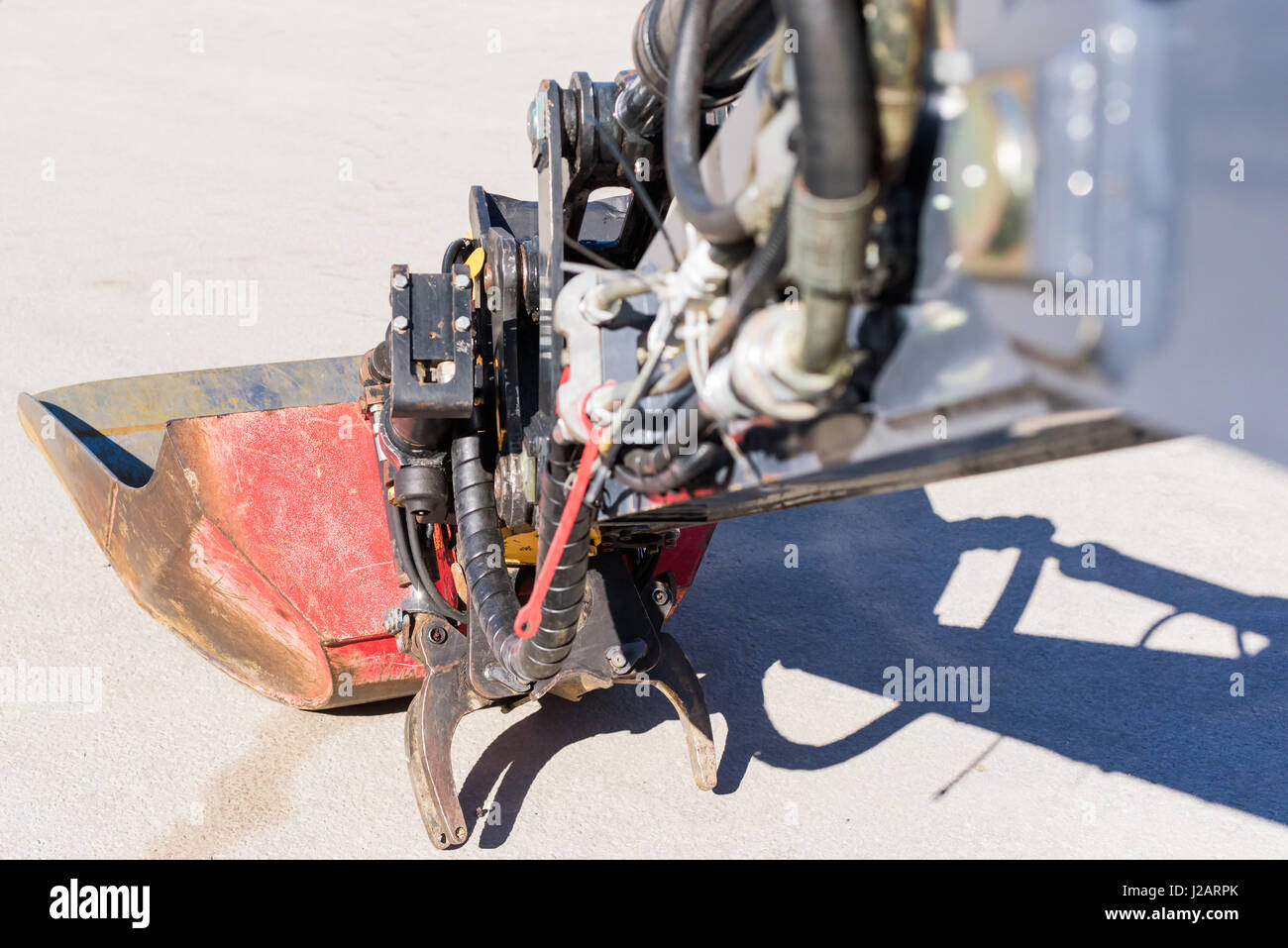 Close up of tractor scoop and grip claw. - Stock Image