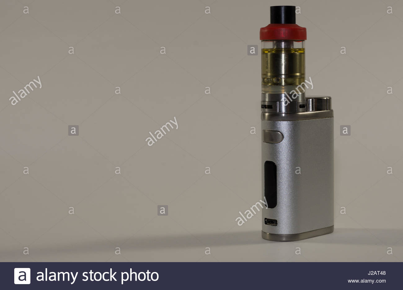 Personal vaping device on white background - Stock Image