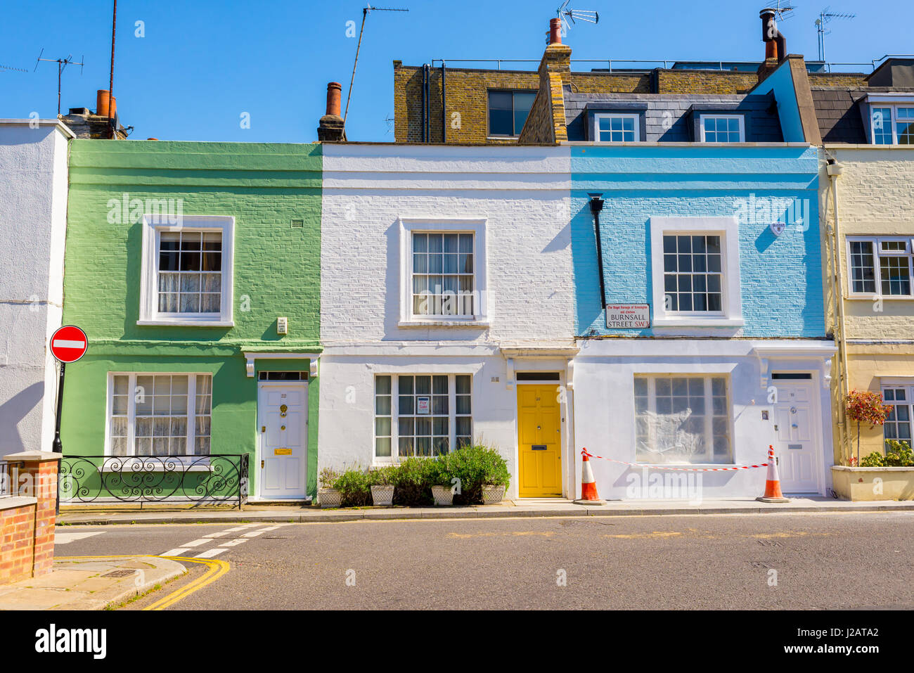 Pastel colored restored Victorian British houses in Burnsall street, Royal Borough of Kensington and Chelsea, London, - Stock Image
