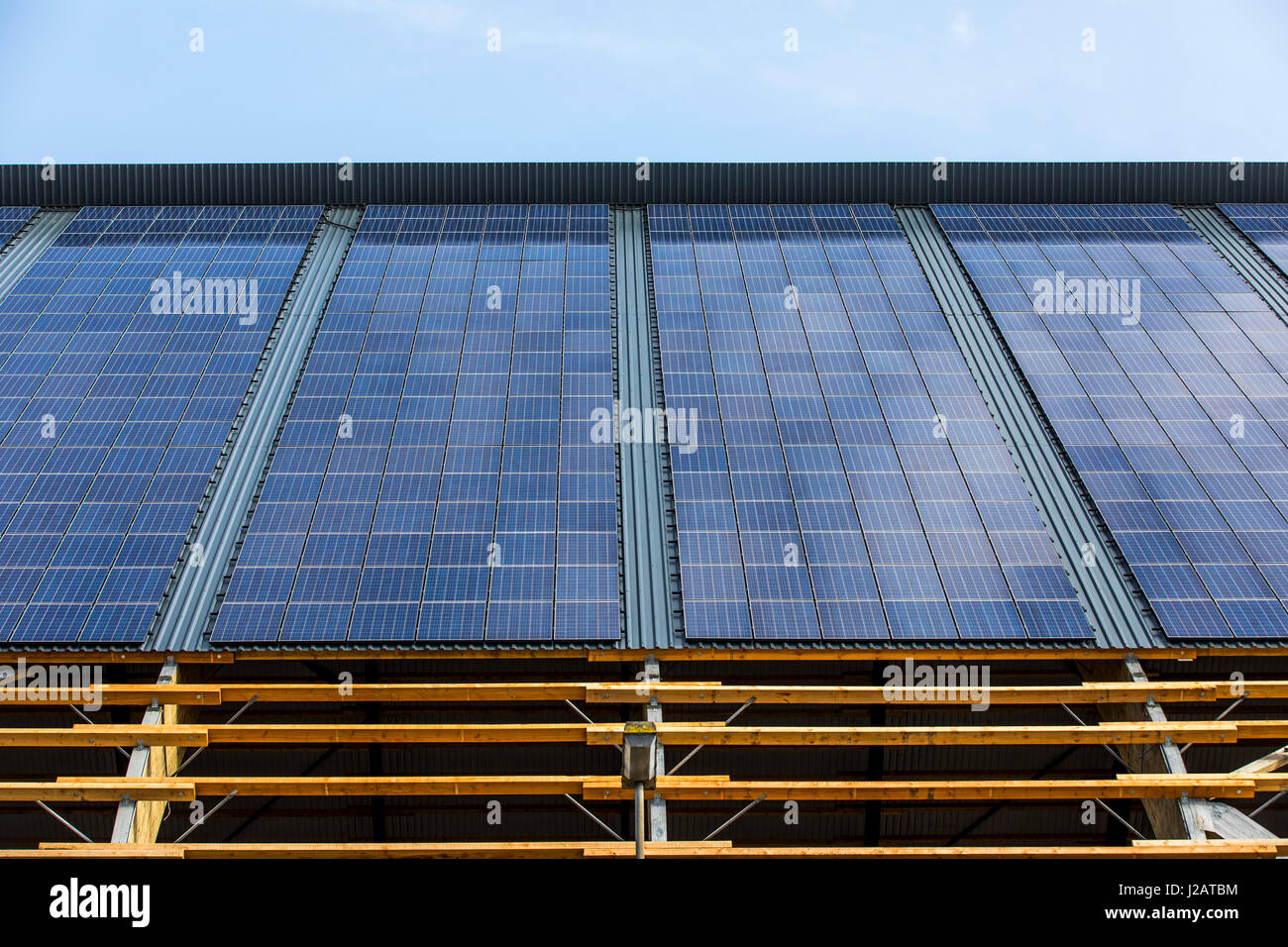 Solar panels roof, solar energy plant on the roof of a logistic hall, of the closed Lohberg colliery,  in Dinslaken, - Stock Image