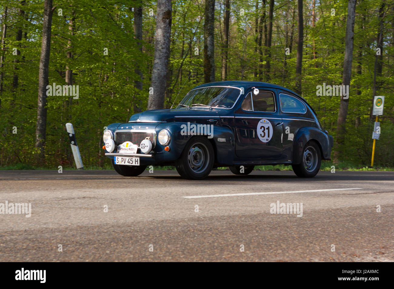 HEIDENHEIM, GERMANY - MAY 4, 2013: Uwe Jaeger and Hans-Ulrich Jaeger in their 1961 Volvo PV 544 at the ADAC Wurttemberg - Stock Image