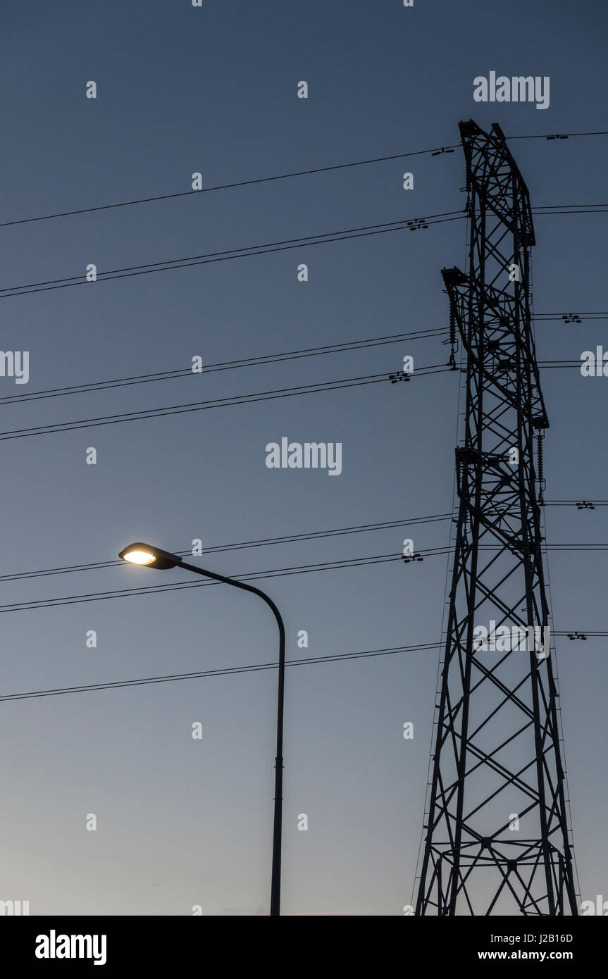 Electricity power cables pylon light street lighting energy. - Stock Image