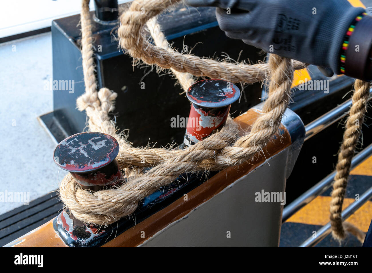 Mooring a Vaporetto water bus on Grand Canal in Venice, Italy - Stock Image
