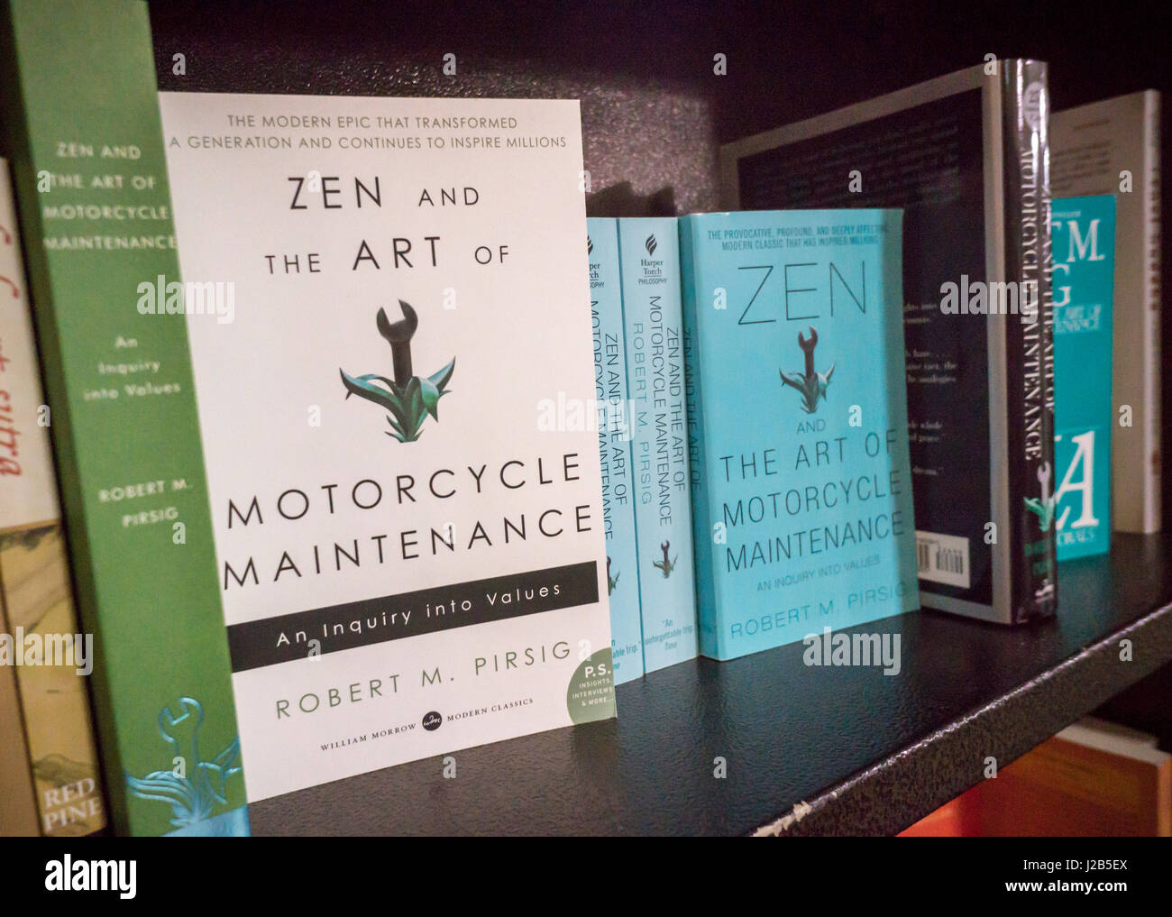 Copies of 'Zen and the Art of Motorcycle Maintenance: An Inquiry into Values' by Robert M. Pirsig is seen - Stock Image
