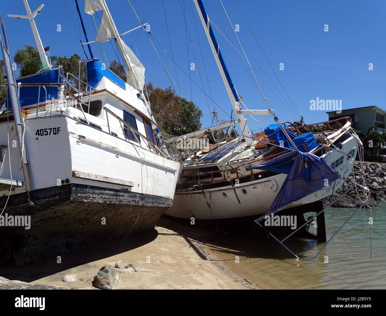 Boats aground resulting from Cyclone Debbie Stock Photo
