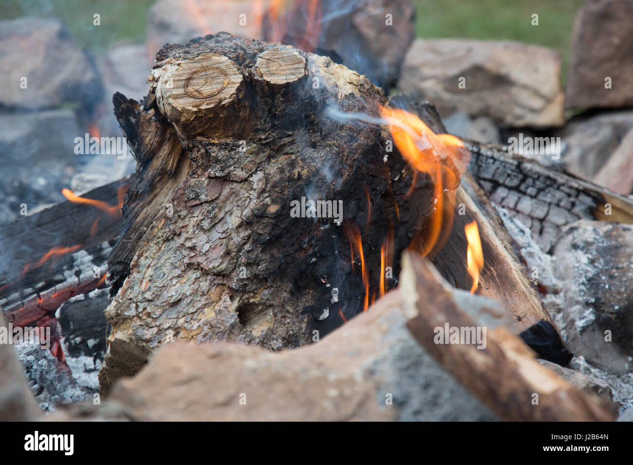 Warm up by the fire - Stock Image