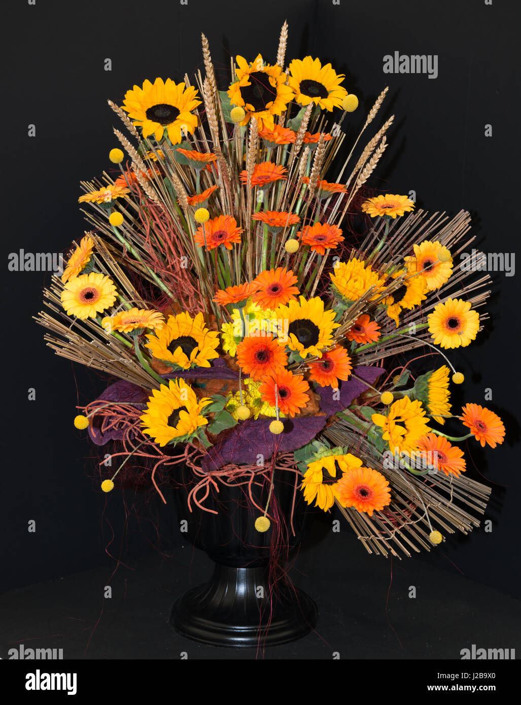 Flower arrangement with orange and yellow flowers and black stock flower arrangement with orange and yellow flowers and black background mightylinksfo