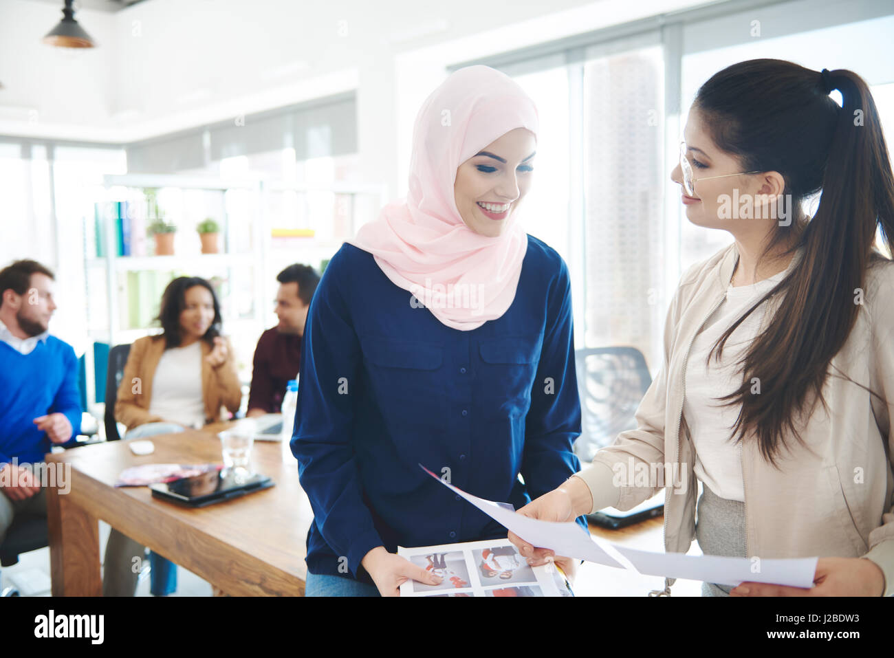 Muslim  with Asian women on business meeting - Stock Image
