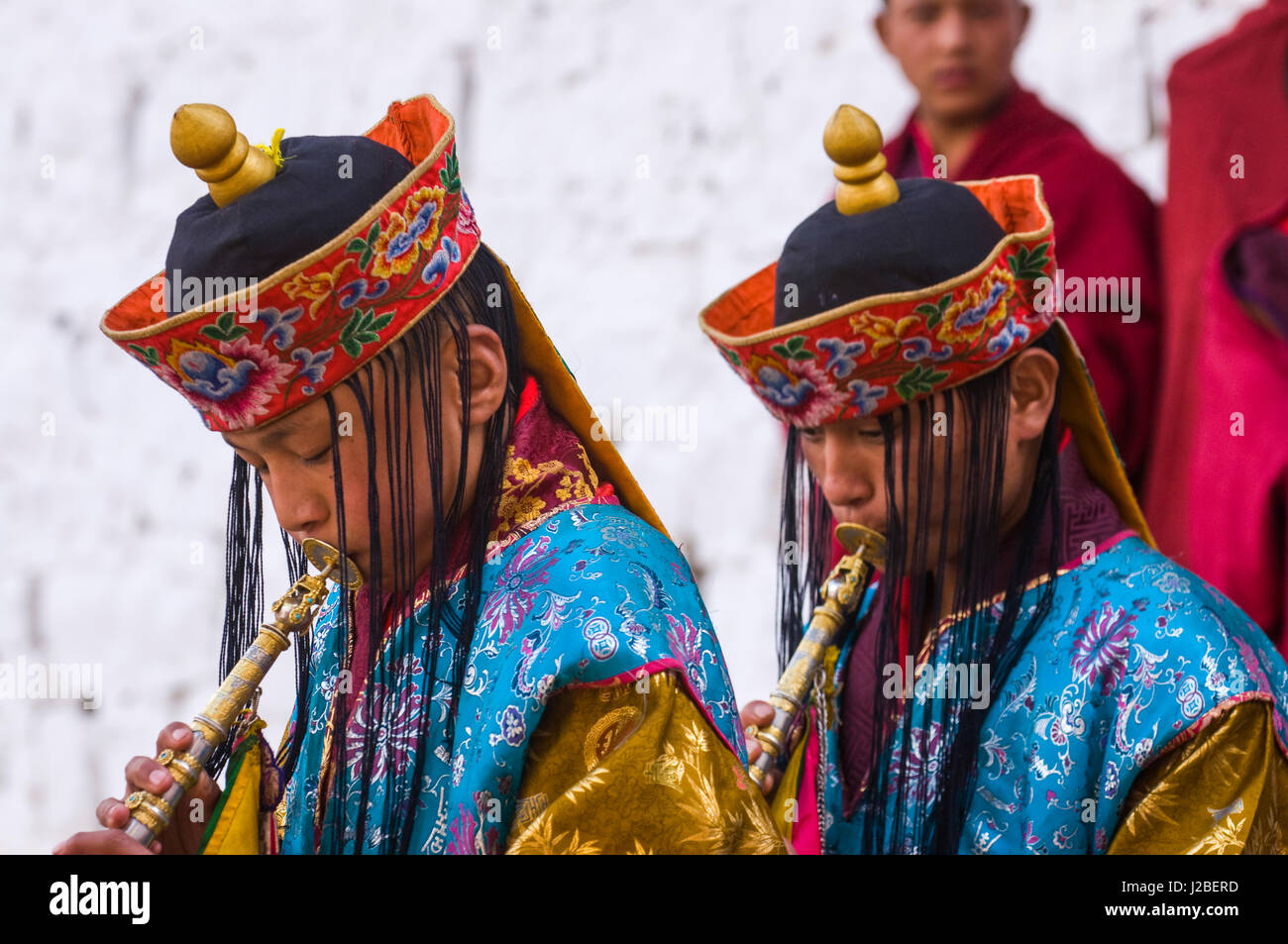 Buddhists playing the flute at religious festivity, Paro