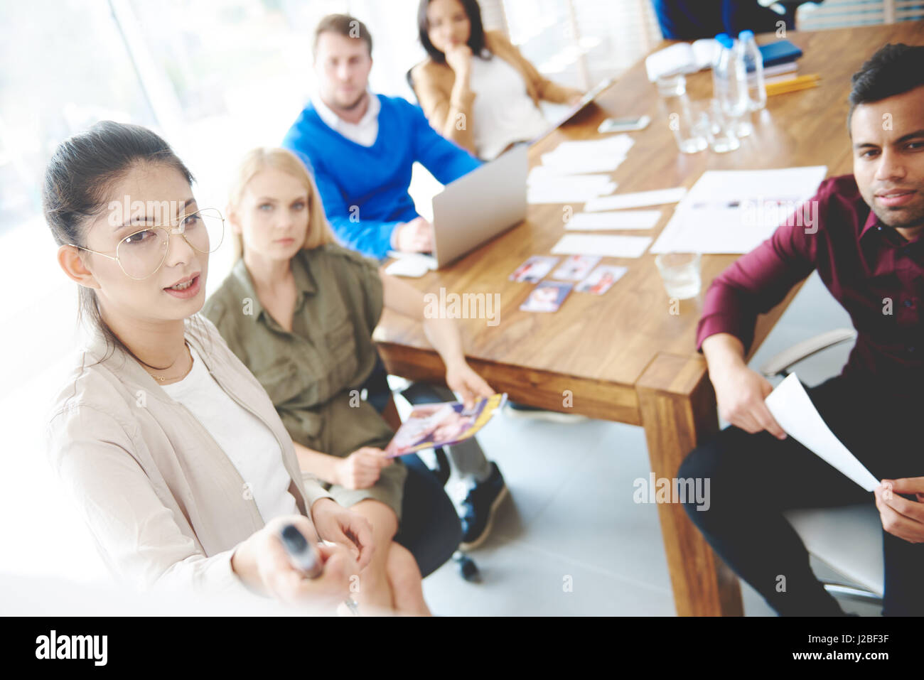 Brainstorming of young business people - Stock Image