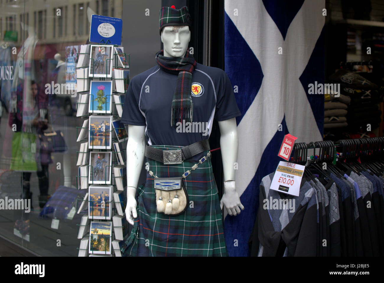 Scotland flag rugby shirt kilt sporran kitsch  6 nations shirt flag postcards shop window - Stock Image