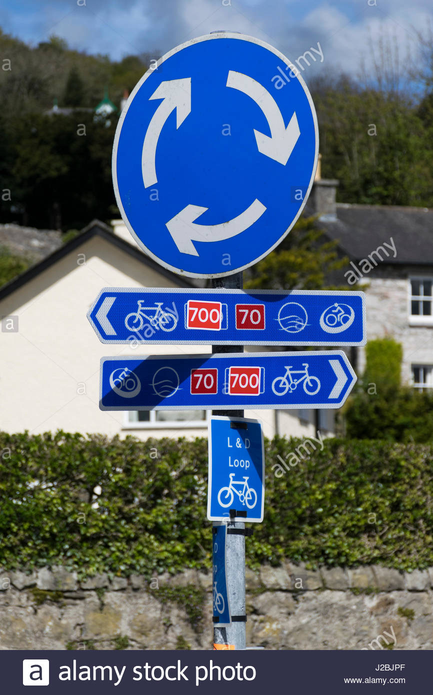 Mini roundabout and cycleway signs at Grange-over-Sands, Cumbria, including signs for the Morecambe Bay Cycle Way - Stock Image