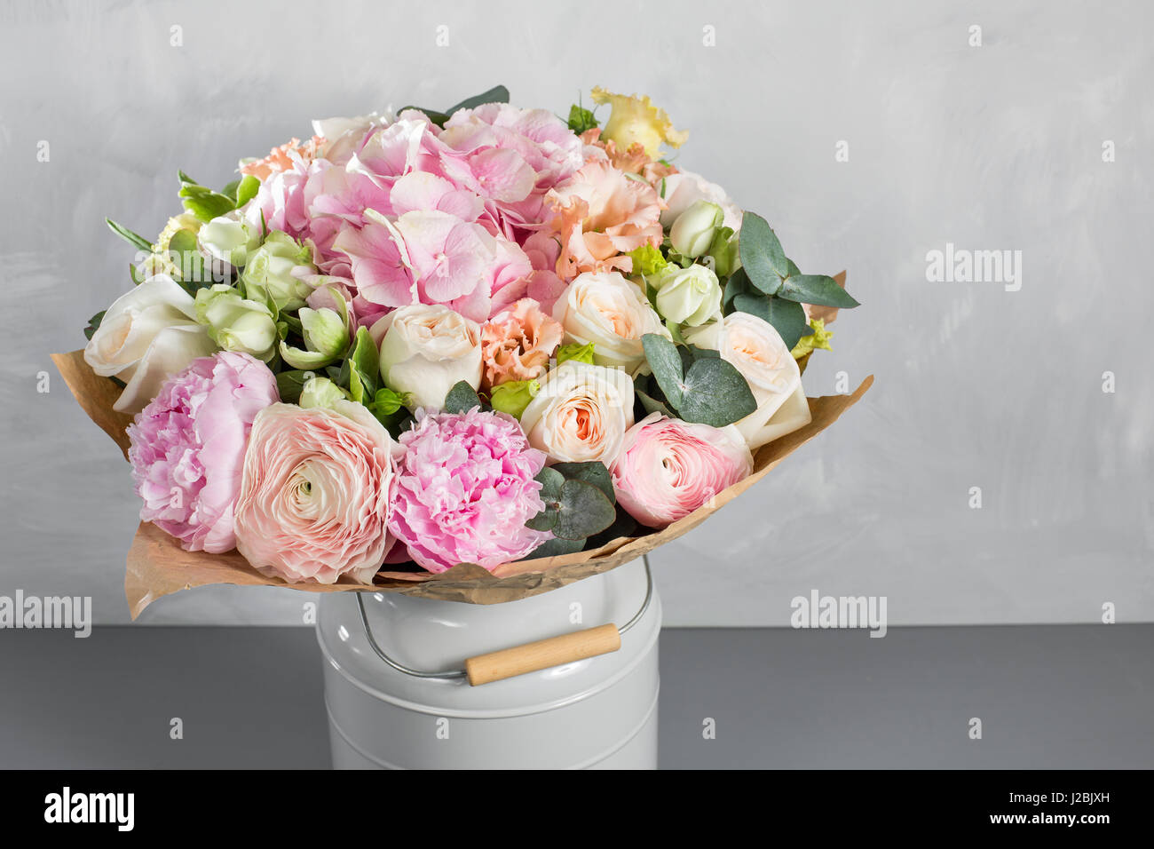 Still life with a bouquet of flowers. the florist put together a beautiful bunch of flowers. Man manual work used - Stock Image