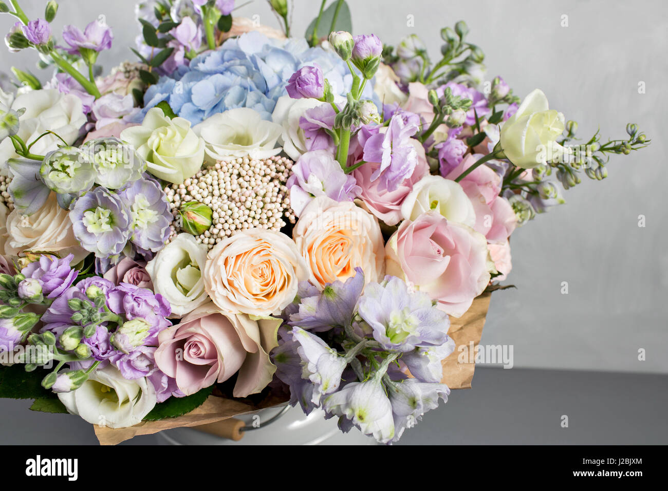 Still life with a bouquet of flowers the florist put together a still life with a bouquet of flowers the florist put together a beautiful bunch of flowers man manual work used different types of flowers and colors izmirmasajfo Images