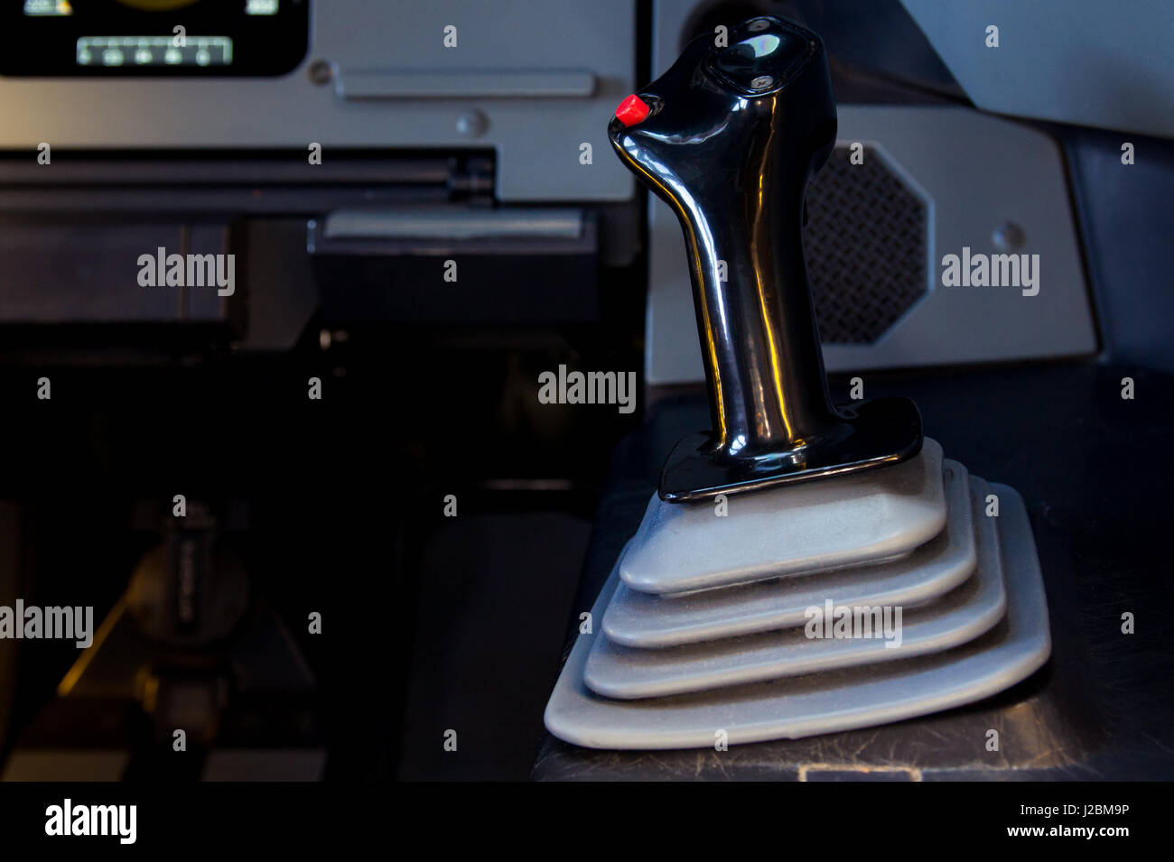 One of the sidesticks in an A320 cockpit with copy space on the left. Right hand side, first officer side. - Stock Image