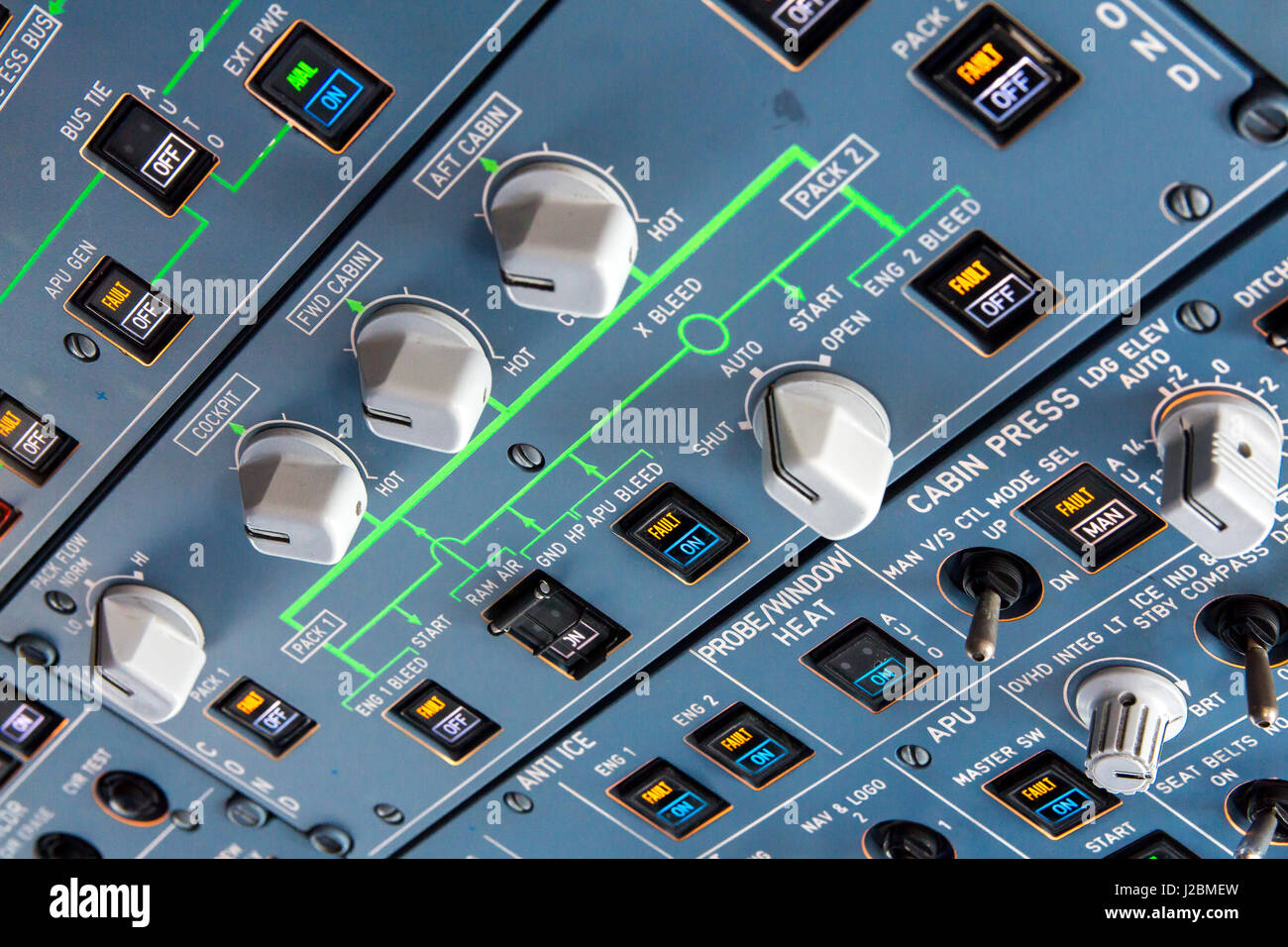 Airbus A320 overhead panel with switches and knobs for controlling various aircraft systems and components. - Stock Image