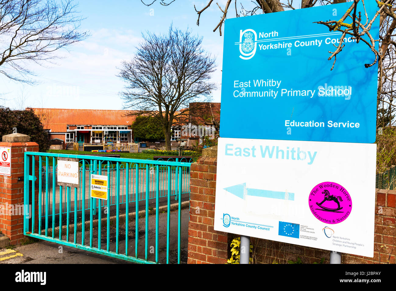 East Whitby Community primary school sign Primary school building exterior school gates school sign UK England Primary - Stock Image