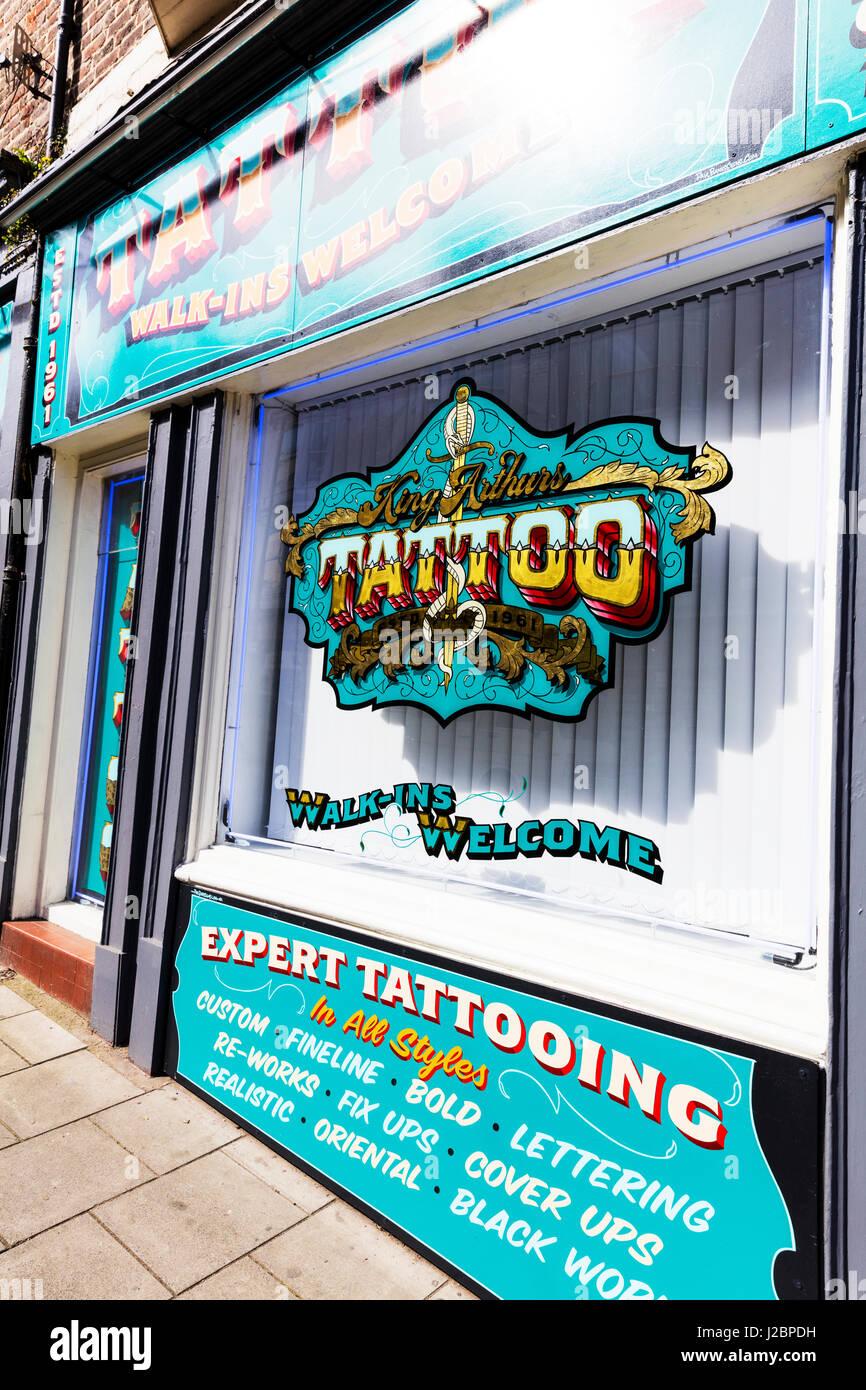 Tattoo shop window tattoo sign tattooing shop window signs tattooist shop sign UK England  tattooing sign - Stock Image