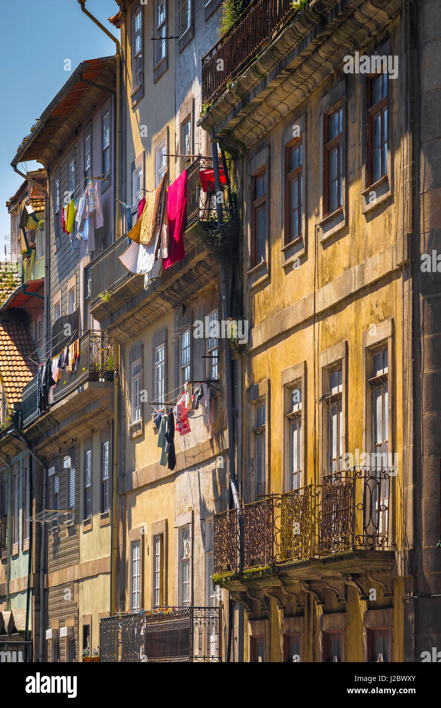 Porto Portugal street, laundry hanging from the balconies of apartments in a street in the Ribeira old town area - Stock Image