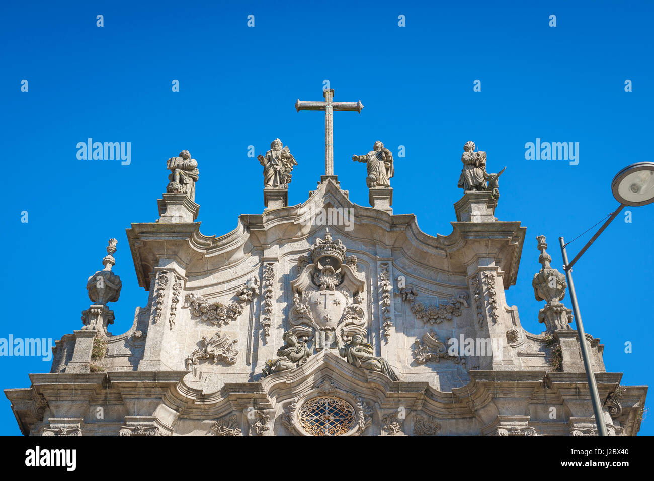 Saints statues church, statues of four saints sited on top of the west end of the Igreja do Carmo, a Baroque church - Stock Image