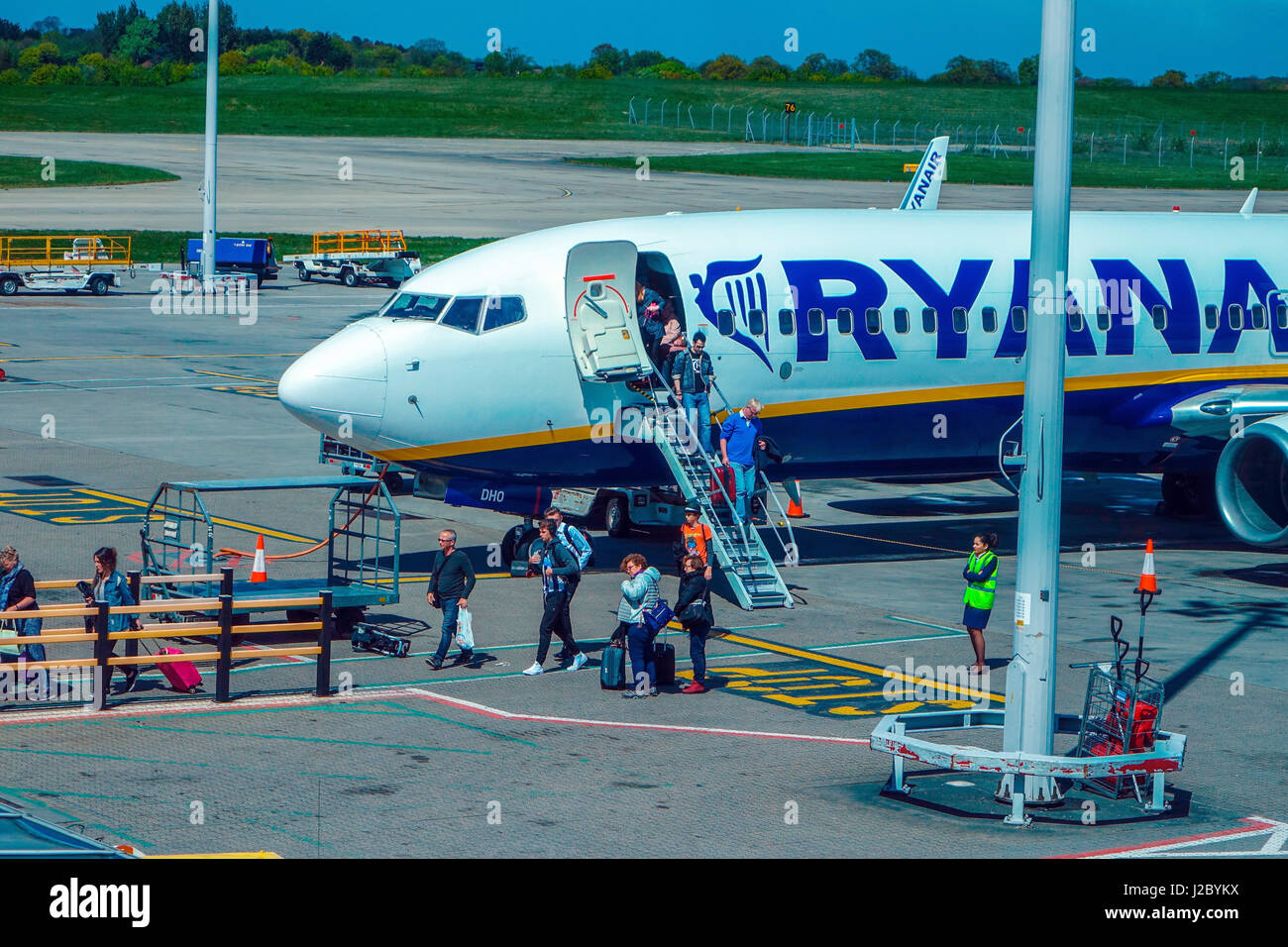 Ryanair Boeing 737 at London Stansted airport with passengers disembarking, - Stock Image