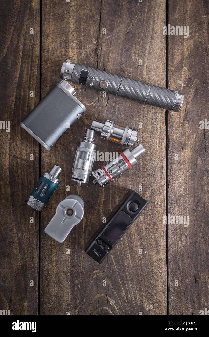 Advanced personal vaporizer or e-cigarette on the table - Stock Image