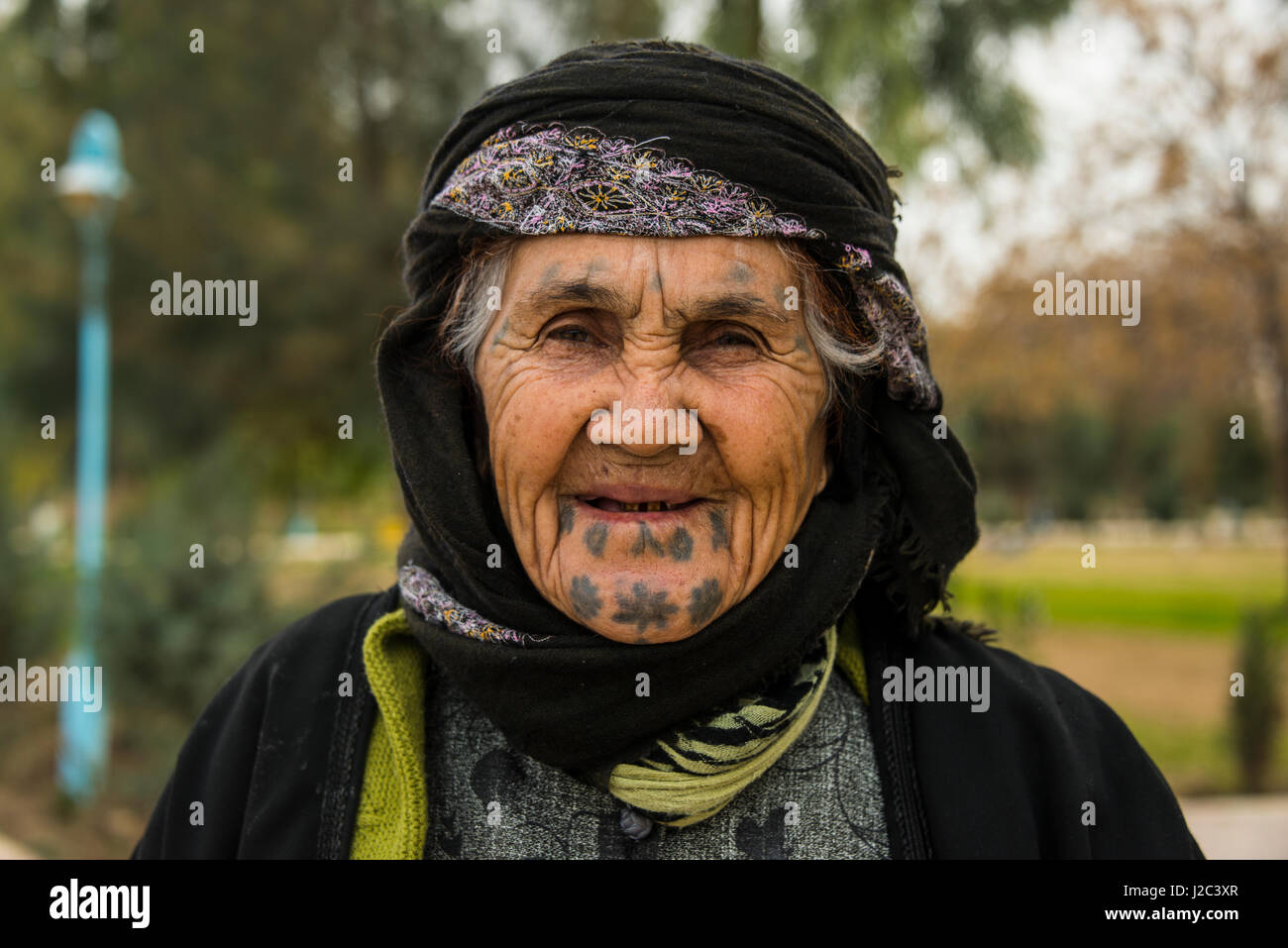 Old Kurdish Woman With Tattoos In Her Face In The Martyr Sami