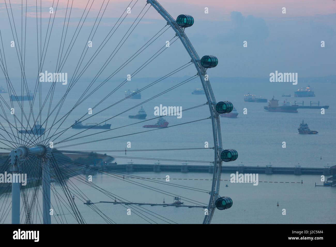 Singapore, Singapore Flyer, giant Ferris wheel, elevated view, dawn - Stock Image