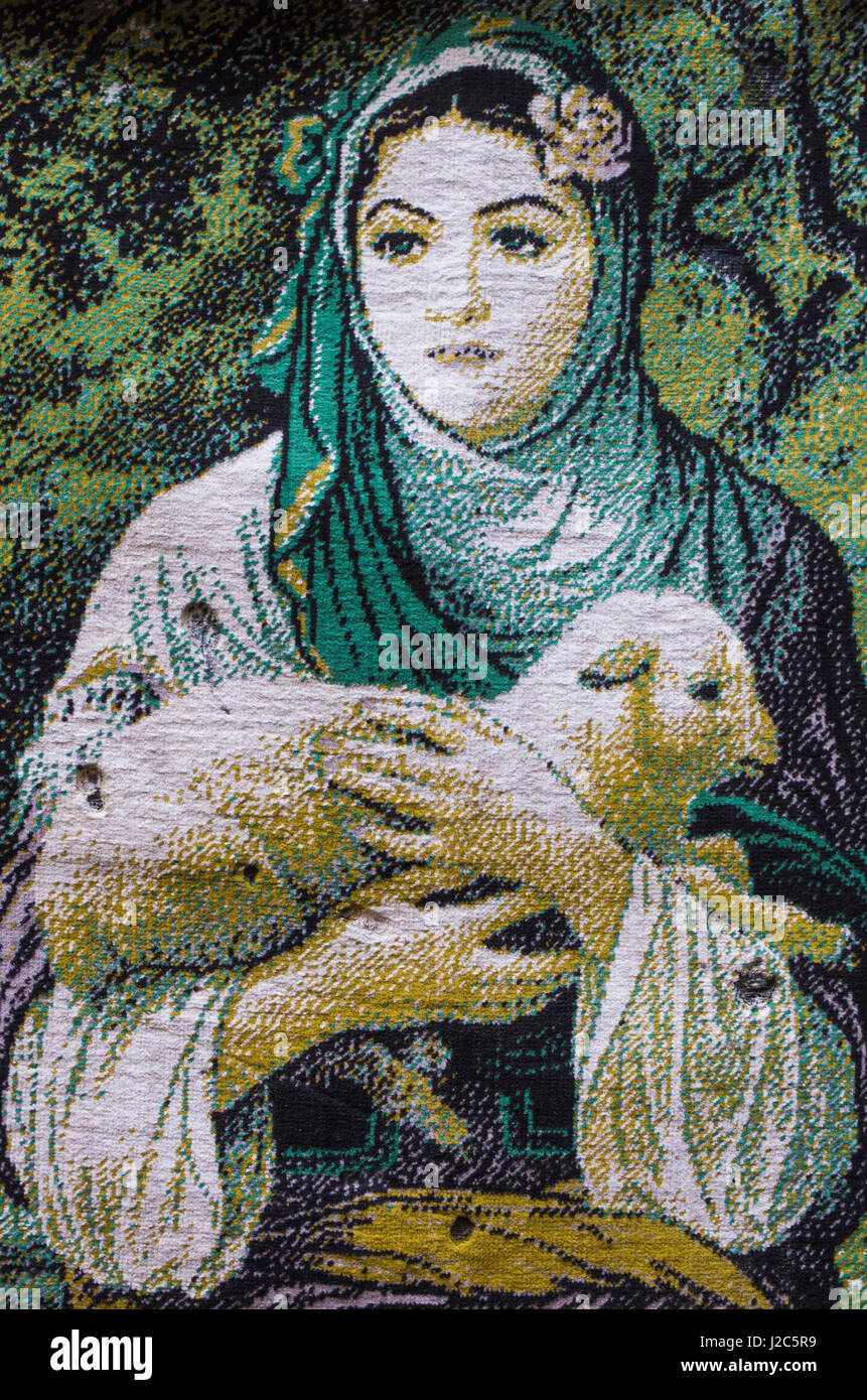 Singapore, Kampong Glam Muslim Area, woman with lamb tapestry - Stock Image