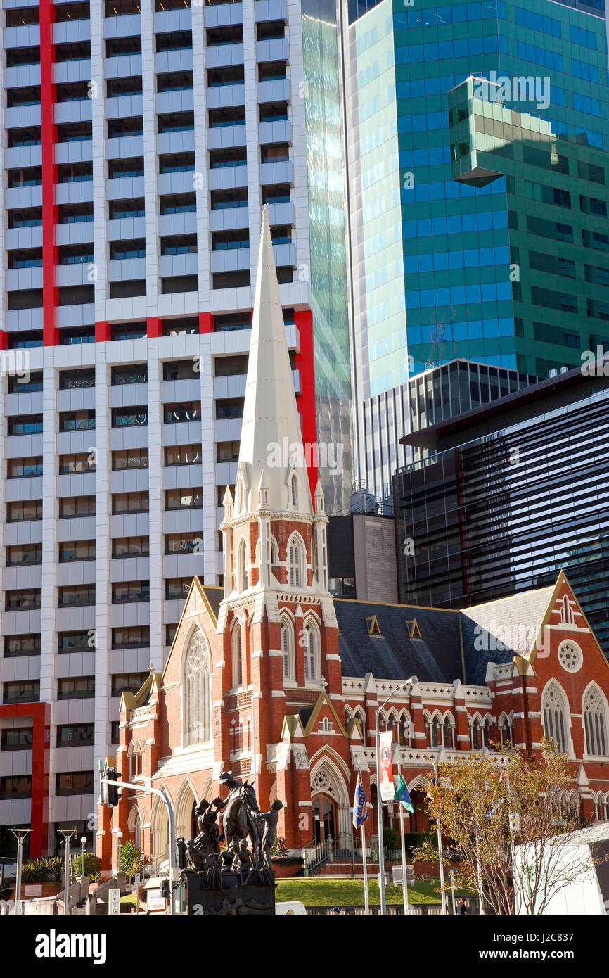 The historic Albert Street Uniting Church surrounded by modern architecture. Brisbane, Queensland, Australia - Stock Image