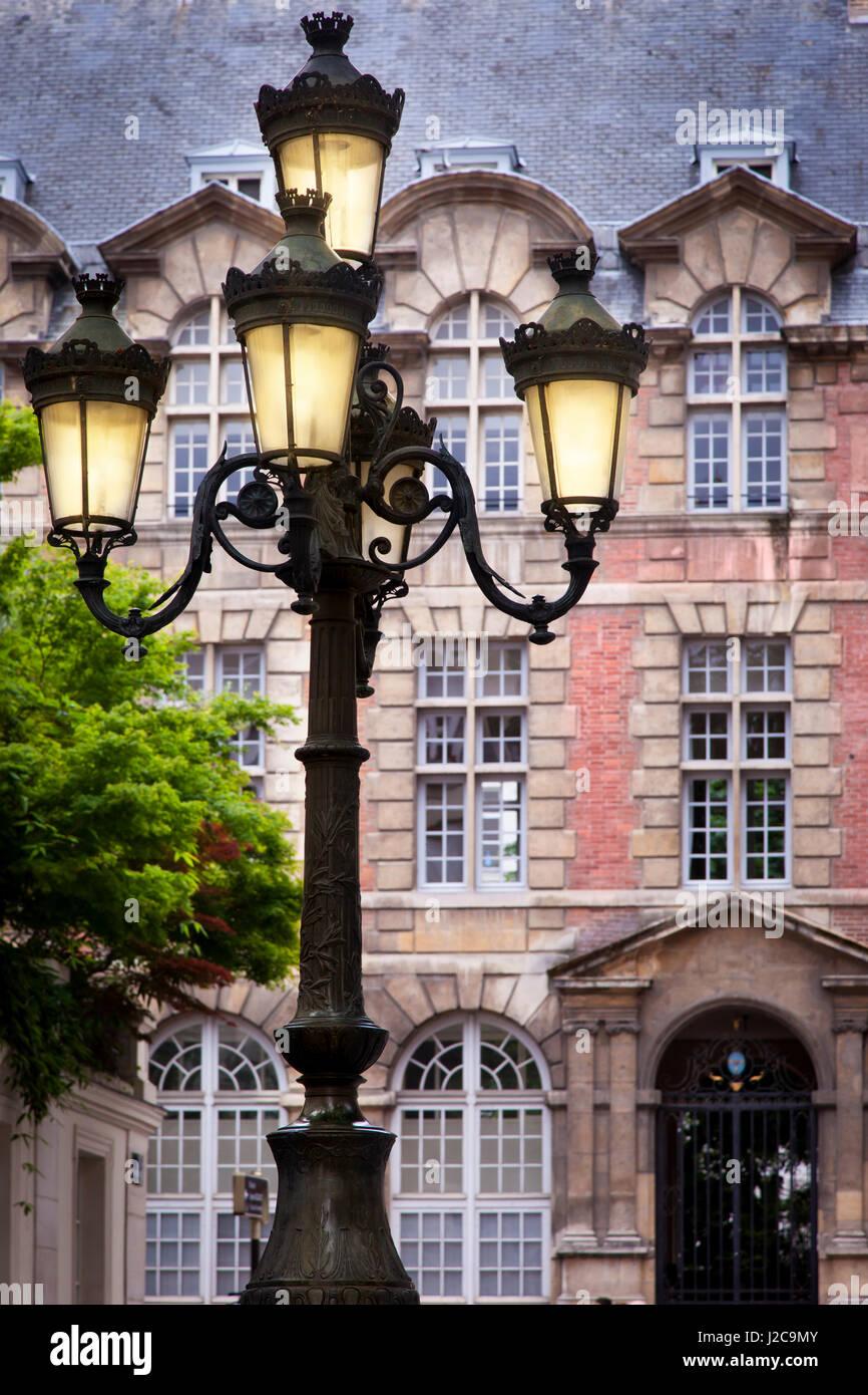 Lamppost at Place de Furstenberg in Saint Germain des Pres with Catholic institute de paris beyond, Paris, Ile-de - Stock Image