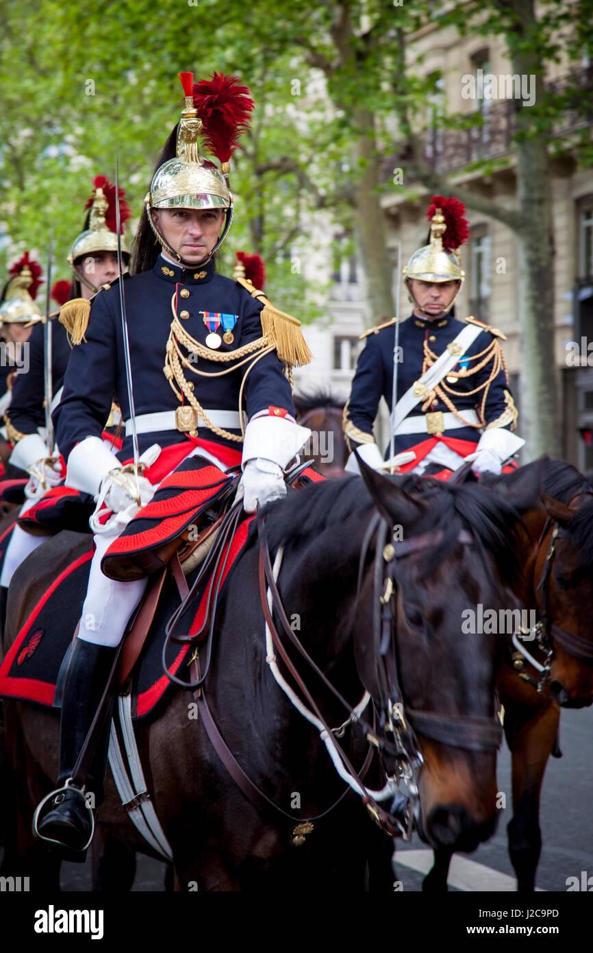 Male and Female Members of the Republican Guard Cavalry Regiment ride down Quai de Gesvres, Paris, Ile-de-France, - Stock Image