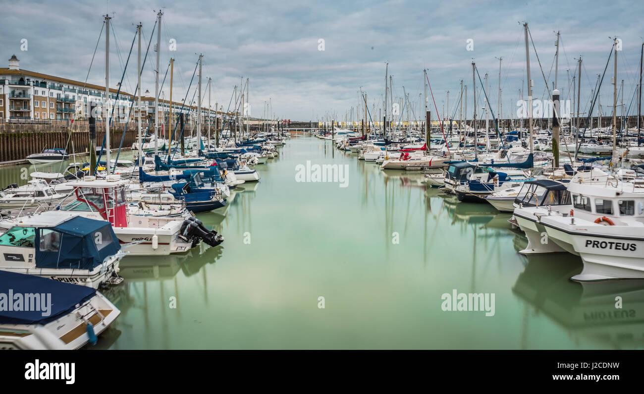 Brighton, England. 13 April 2017.Boats, yachts, and fishing boats moored at Brighton Marina docs on a cloudy day. - Stock Image